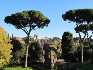 view from the Palatine Hill across to the Caelian Hill. The church of Saints John and Paul in the distance, the remains of a branch of the Aqua Claudia in the foreground.